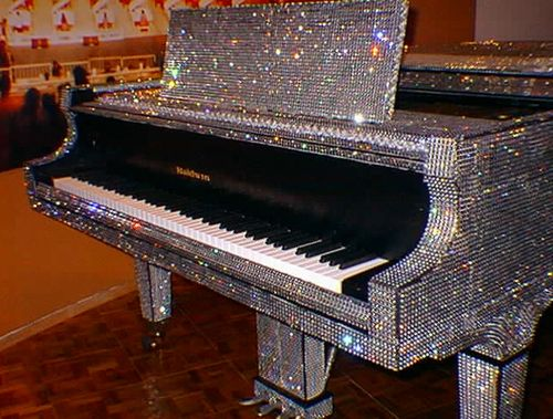 Everyone has a friend that is obsessed with sparkly, glittery things or everything Liberache. Here is the perfect piano for that friend that just can't help bedazzling everything they own.