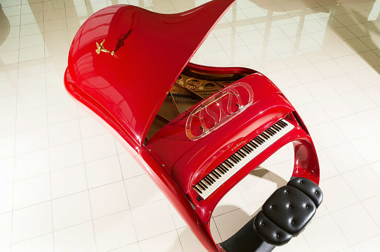 Can you imagine this Schimmel Pegasus Goquin masterpiece of futuristic heaven sitting in your living room? Since it is uber sleek and painted with Ferrari Rosso Red you shouldn't be surprised that is costs over $400,000 dollars.